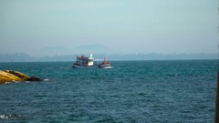 The ship floats on the ocean without sails and with people on the horizon in Stock Footage