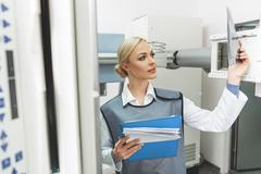 Attentive female doctor in roentgen room Stock Photos