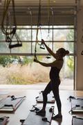 Caucasian woman adjusting resistance bands in gymnasium Stock Photos