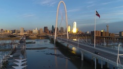 Dallas skyline Aerial w/famous bridge, park and Texas Flag flying Stock Footage
