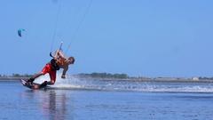 A man kiteboarding on a kite board. Stock Footage