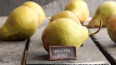 Healthy food - tag with an inscription and pears on rural table Stock Footage