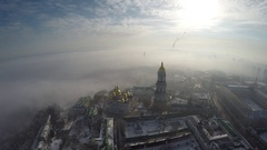 Aerial view Kiev-Pechersk Lavra in winter fog, 4K, raw Stock Footage