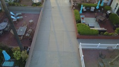 Aerial drone uav view of a boy playing soccer football on a walk street  Stock Footage