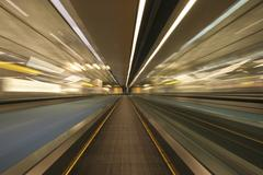 Blurred motion of moving walkway Stock Photos