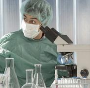 Caucasian scientist surprised in laboratory Stock Photos