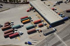 Aerial view of cargo containers on semi-trucks Stock Photos