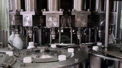 Part Automatic Line for Bottling Milk . Filling the Bottles with Milk Stock Footage