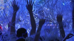 Footage of a crowd partying, dancing slow motion on the paper party. Stock Footage