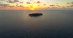 Aerial drone view of scenic tropical islands at sunset in the Maldives. Arkistovideo