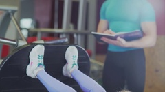 Woman at the gym performing the leg press exercise lying down Stock Footage