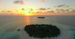 Aerial drone view of scenic tropical islands at sunset in the Maldives, time-lap Stock Footage