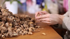 Female hand selected folder with walnut Stock Footage