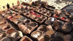 Moroccan traditional culture, dyeing animal skins in tannery vats Stock Footage