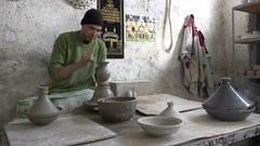 Pottery maker at work in ceramics studio Fez, Morocco Arkistovideo