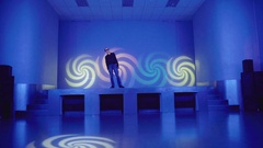 Hypnotized man standing on stage and swinging Stock Footage