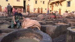Men at work in tannery workshop, employment manual labor Morocco North Africa Stock Footage