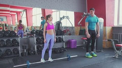 Young woman at the gym doing deadlifts. Personal training in the gym Stock Footage