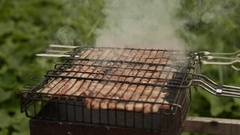 Meat cook fried metal grid outdoors Stock Footage