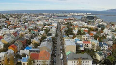 Top view on panorama of Reykjavik city and old harbour, view from famous church Stock Footage