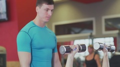 Young athletic girl training with a personal trainer. Inventory Stock Footage