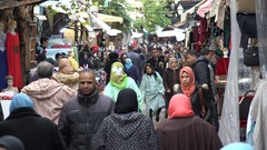 People visit a shopping street in Fez, Morocco Stock Footage