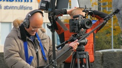 Reykjavik, Iceland - SEP 26, 2016: cameraman and soundman work outdoor, making Stock Footage