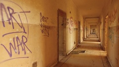 Steadicam graffiti promoting peace in old hospital on Golan Heights, Israel Stock Footage