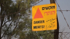 Warning sign against old landmines in Golan Heights, Israel Stock Footage