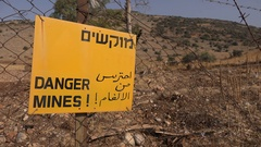 Fence warning sign old minefields, former war region Golan Heights Israel Stock Footage