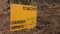 Safety security Israel, warning sign against mines on Golan Heights Stock Footage