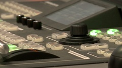 The remote is in the TV Studio Stock Footage
