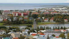 Top panorama of Reykjavik city with lake Tjornin in autumn time, calm cityscape Stock Footage