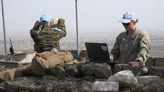 United Nations observers at Israel Syria border, coordinates on laptop Stock Footage