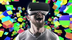 Emotional smile happy man wearing virtual reality goggles. VR headset. Within Stock Footage