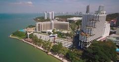 Resorts and Condos on Headland in Pattaya, Thailand, Descending Pan Shot Stock Footage