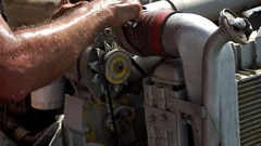 A man welds a tube with a metal clamp. About industry Stock Footage