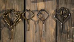 Different metal buckles hanging on the wooden wall in the workshop closeup Stock Footage