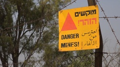 Warning sign for old minefields in Golan Heights in Israel Stock Footage