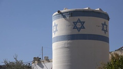 Water tanks with Israeli national flag in settlement Hebron Stock Footage