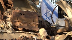 Monument of destroyed tank with Israeli flag on Golan Heights Stock Footage