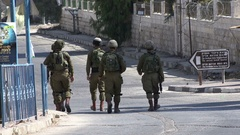 Israeli Defense Forces soldiers patrol streets of Hebron, security West Bank Stock Footage