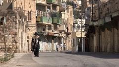 Jewish Orthodox man walks through empty streets Israeli settlement Stock Footage