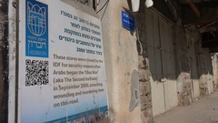 Explanation sign at the former bazaar in central Hebron in the West Bank Stock Footage