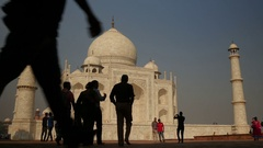 Silhouettes of tourists visiting the Taj Mahal in India Stock Footage