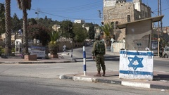 Israeli soldier at checkpoint in Hebron settlement in the West Bank Stock Footage