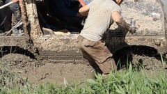 Man in the mud trying to help Stock Footage
