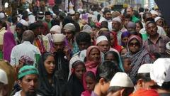 Peolpe walk through busy street nearby Islamic shrine in Ajmer, India Stock Footage