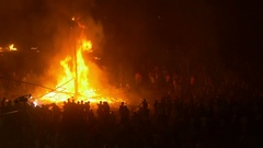 Devotees gather around fire of Dussehra puppets, religious festival India Stock Footage