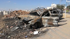 Burned car wreck dumped on a garbage site in Hebron in the West Bank Stock Footage
